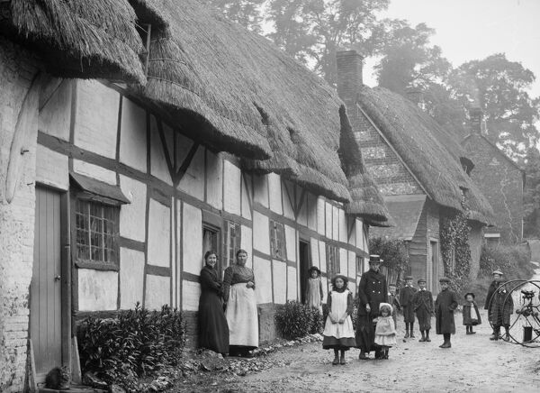 Ramsbury, Wiltshire. Women and children posing outside a thatched cottage. Photographed by Frederick Ault. Part of the Henry Taunt collection (1860-1922)