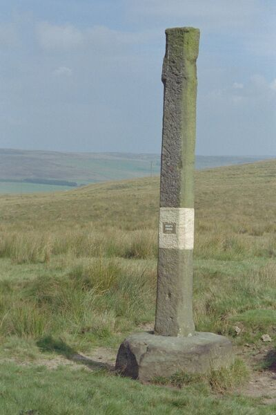 Wayside cross in an isolated position on wild moorland overlooking Gorple Lower Reservoir, West Yorkshire. IoE 423310
