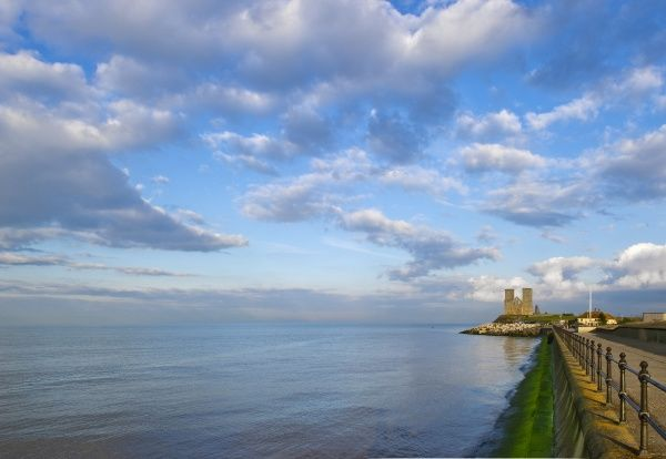 RECULVER TOWERS AND ROMAN FORT, Kent. Distant view along sea front
