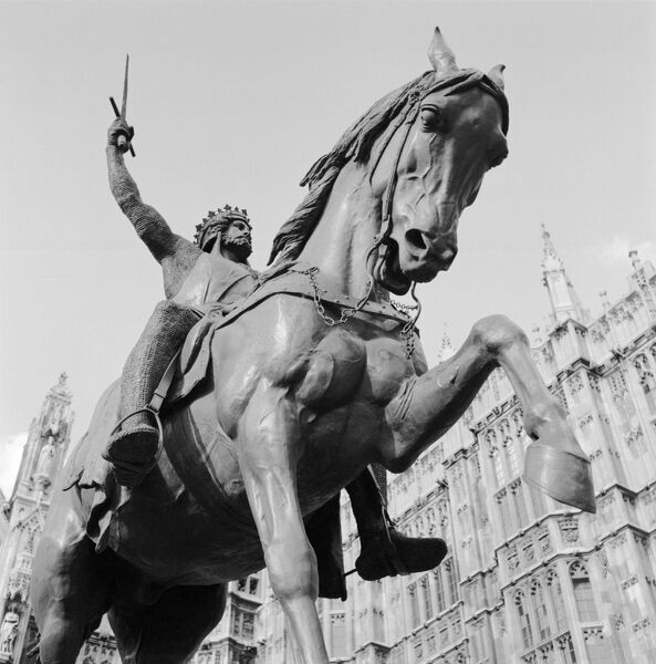 OLD PALACE YARD, Westminster, London. Detail view of the Richard Coeur de Lion statue looking up towards the equestrian bronze figure. It was made in 1860 by Carlo Marochetti. Photographed by Eric de Mare. Date range: 1945-1980