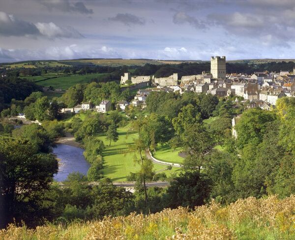 RICHMOND CASTLE, North Yorkshire. View of castle, town and river from the hillside