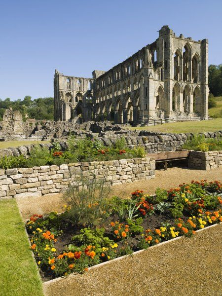 RIEVAULX ABBEY, North Yorkshire. General view of the sensory garden with abbey in the background