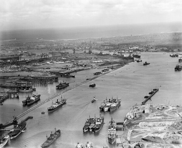 Aerial view of the Tyne River looking towards Tynemouth and Jarrow, August 1935. Lots of shipping in the river and in dock. Aerofilms Collection (see Links)