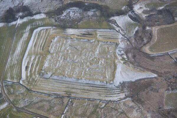 Habitancum Roman Fort, Risingham, Northumberland. Aerial view with light snow accentuating the earthworks. NY8986/17