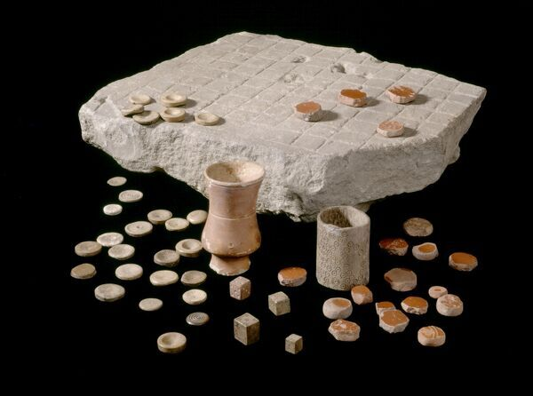 CORBRIDGE ROMAN TOWN, Northumberland. A gaming board with dice and counters. hadrian