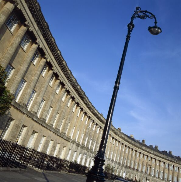 THE ROYAL CRESCENT, Bath, Avon. An oblique view of the Crescent showing its curvature with an ornate street lamp in the foreground