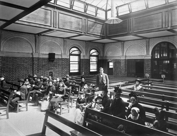 ROYAL NORTHERN HOSPITAL, Holloway Road, Holloway, Islington, Greater London. Interior of the out-patients waiting room, showing poeple waiting to be seen. Photographed by Bedford Lemere for Lord Ashburton in 1888