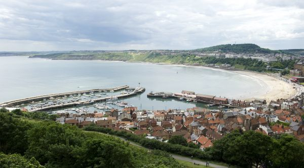 SCARBOROUGH CASTLE, North Yorkshire. View from the castle over South Bay, harbour and town