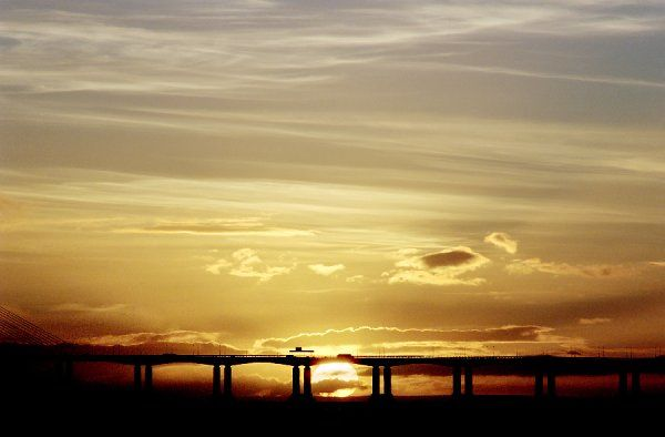 SECOND SEVERN CROSSING, Severn Beach, South Gloucestershire. View of the bridge at sunset
