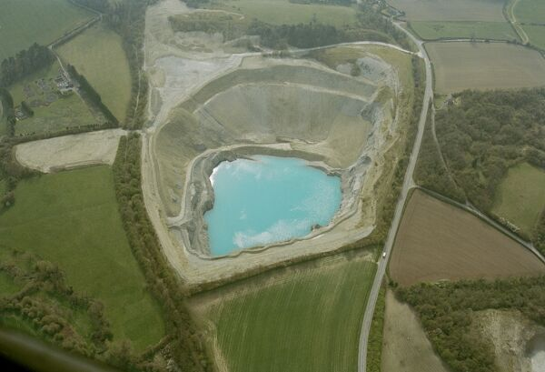 Shadwell Quarry, near Much Wenlock, Shropshire. The basin of the quarry has filled with water and the limestone quarried here has helped to give this a rich blue colour. The limestone from the quarries in this area have been used for roadstone