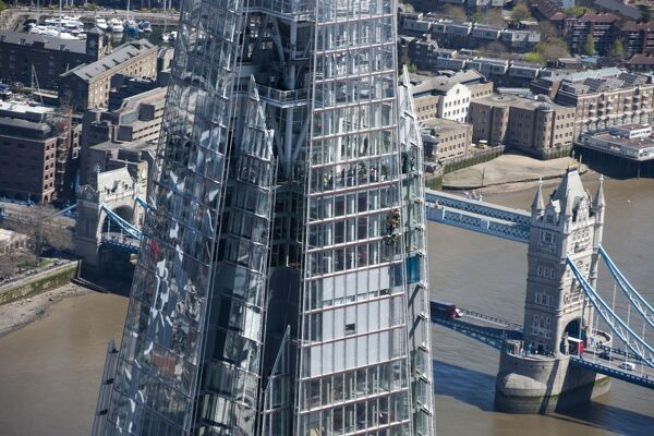 The Shard, Southwark, London. Designed by architect Renzo Piano and completed in 2012. Detail with Tower Bridge beyond, photographed in May 2013