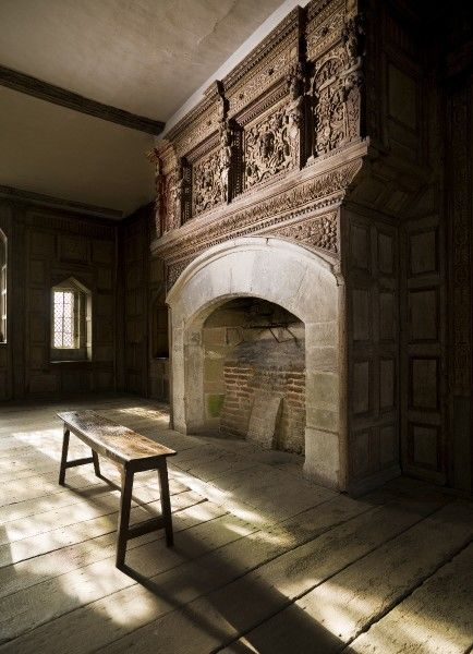 STOKESAY CASTLE, Shropshire. Interior view of the Solar Room showing the seventeenth century carved overmantel above the fireplace