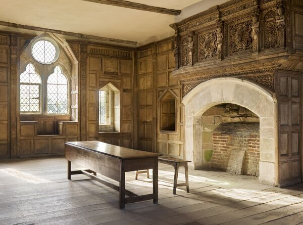 STOKESAY CASTLE, Shropshire. Interior view. The Solar room showing the wood panelling and carved overmantel above the fireplace