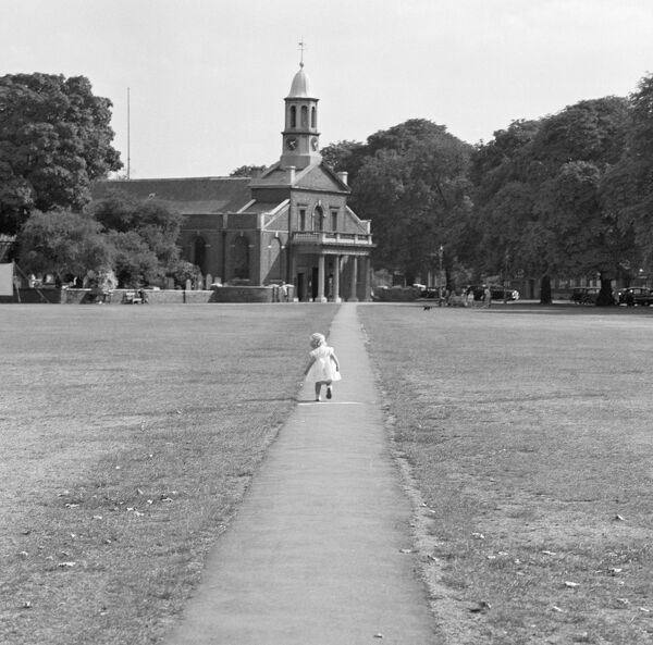 ST ANNE'S CHURCH, Kew Green, London. A small girl running along the path to the entrance to St Anne's Church. Photographed by John Gay sometime between January 1962 and May 1964