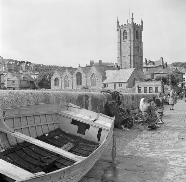 ST IA'S CHURCH, St Ives, Cornwall. The east end of the early 15th-century church of St Ia, St Ives, seen from the harbour. A boat is pulled up in the foreground. Photographed by Eric de Mare between 1945 and 1980