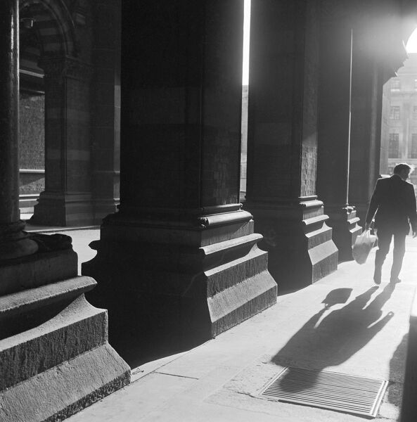 ST PANCRAS HOTEL, London. A man walking beside the massive portals outside the Midland Grand Hotel porte cochiere at St Pancras railway station. John Gay. Date range: 1960-1972