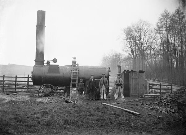 Workers at Charwelton, Northamptonshire. Construction workers on Great Central Railway. The workers have a large steam engine for power and a small makeshift hut for shelter at the ironstone quarry near the village. Photographed by Alfred Newton