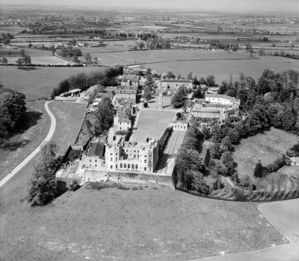 The Stoke Park Colony (Stoke Park Hospital), Stoke Gifford, near Bristol, South Gloucestershire, 13th May 1947. The, now yellow, Dower House, sitiuated on the balustraded terrace, remains a prominent landmark. Aerofilms Collection