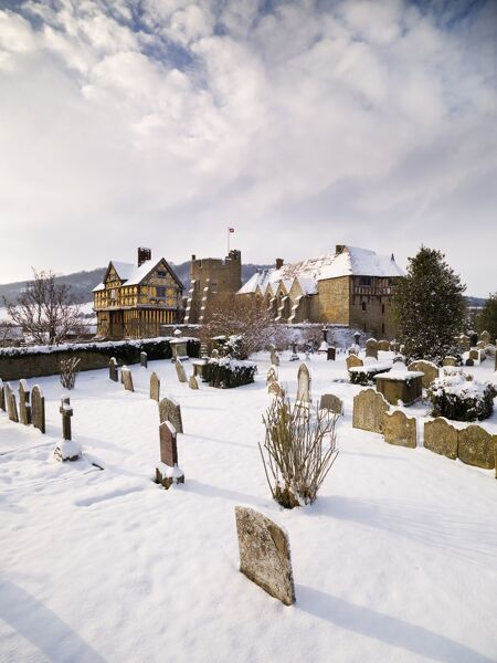 STOKESAY CASTLE, Shropshire. View across the snow covered graveyard showing the Gatehouse and the South and North Towers