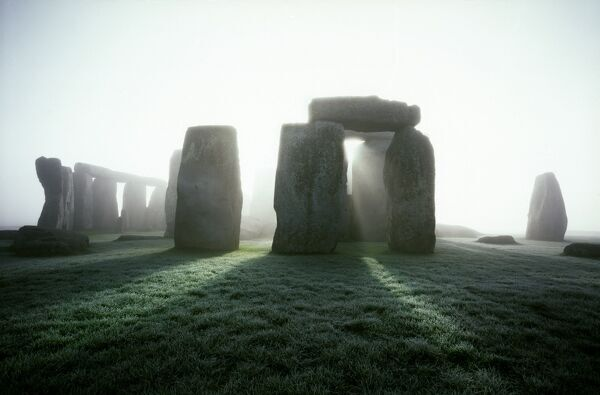 STONEHENGE, Wiltshire. Misty view from the North East at sunrise