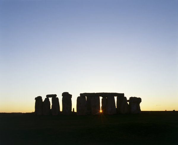 STONEHENGE, Wiltshire. General view at sunrise