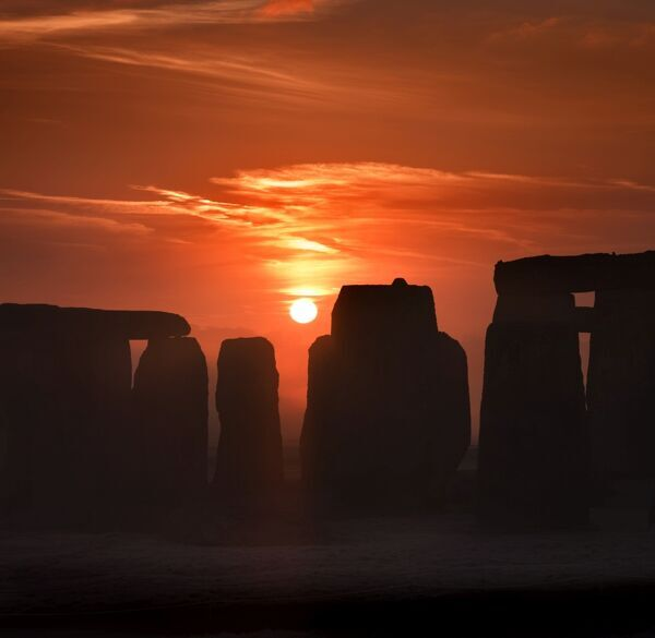 STONEHENGE, Wiltshire. View of Stonehenge at sunrise