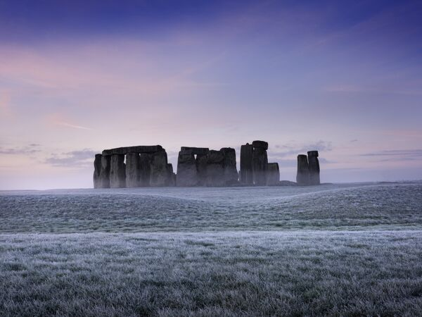 STONEHENGE, Wiltshire. View of the stone circle at early dawn