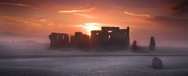 STONEHENGE, Wiltshire. View of the stone circle at sunrise