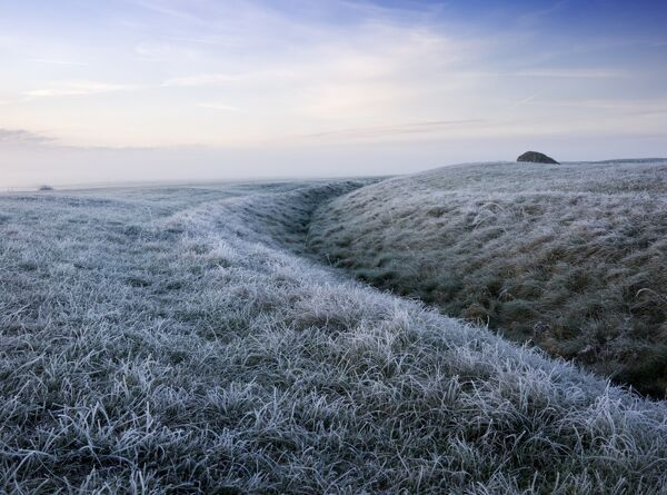 STONEHENGE, Wiltshire. View of the outer ditch. Frosty early morning view