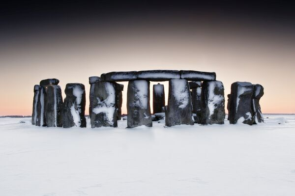 STONEHENGE, Wiltshire. General view of Stonehenge in the snow