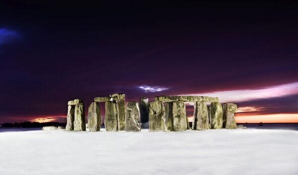 STONEHENGE, Wiltshire. General view of Stonehenge at twilight showing recent snowfall