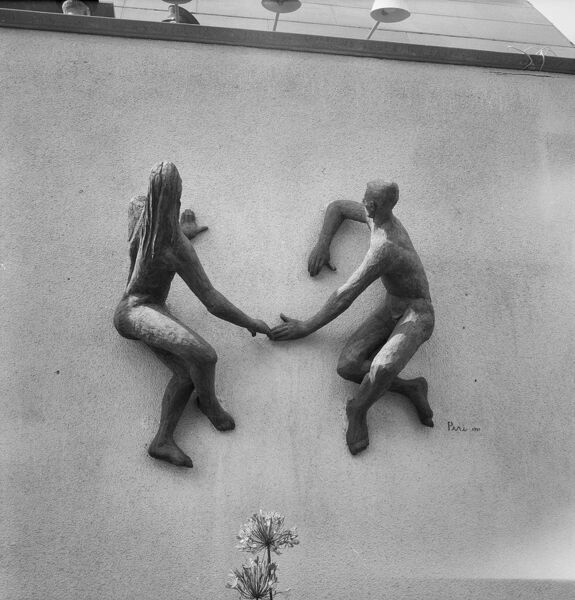 Festival of Britain 1951, Lambeth, London. The sculpture of a man and woman holding hands by L Peri on the north wall of the Station Gate of the South Bank Exhibition site. Photographed by M W Parry