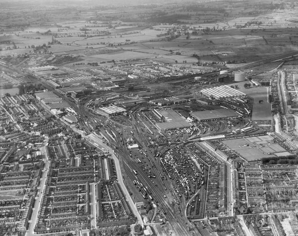 SWINDON, Wiltshire. The Great Western Railway Works, Swindon station and the workers village (Swindon New Town), looking west. Photographed in August 1938. Aerofilms Collection (see Links)