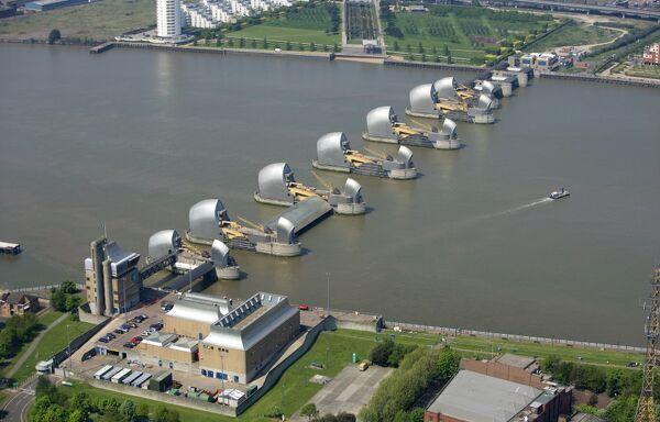 THAMES BARRIER, Woolwich Reach, London. Aerial view. A flood control structure built between 1974 and 1984 to help protect London from flooding. Downstream of the capital the barrier is intended to control tidal and storm surges coming up the river