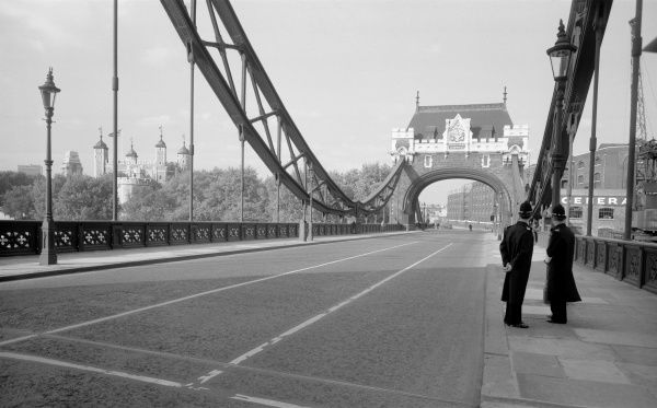 TOWER BRIDGE, Tower Hill, Stepney, London. General view from the middle of Tower Bridge looking towards the north bank. Two police officers are conferring. Photographed by Eric de Mare. Date range: 1945-1980