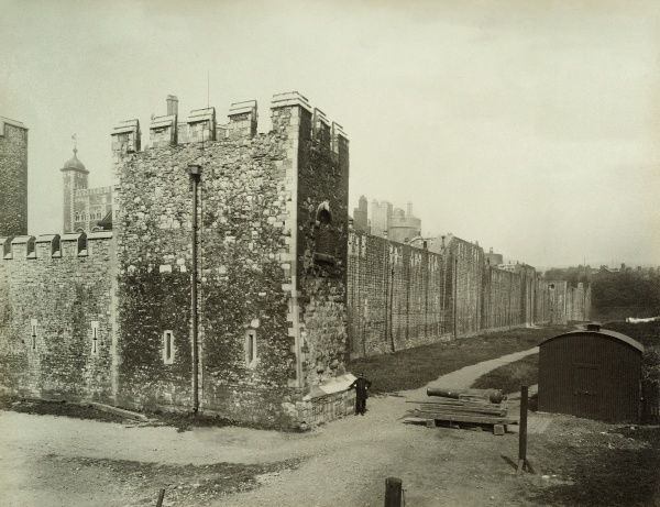 TOWER OF LONDON. Exterior view of Develin Tower, the most easterly tower in the outer ward of the castle. It was refaced in the 19th century as part of Anthony Salvin's restoration works. Photographed in 1883 by Bedford Lemere