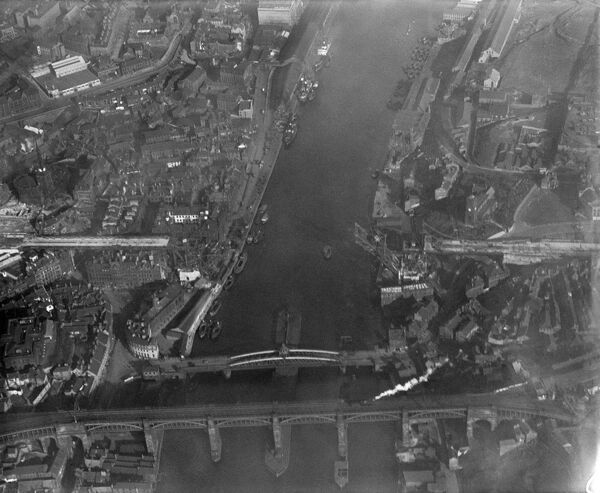 TYNE BRIDGE, Newcastle. Site of the new Tyne Bridge, photographed here in October 1927, a year before official opening of the bridge - the approaches are well underway. Also shown are Robert Stephenson's innovative High Level Bridge (1849)