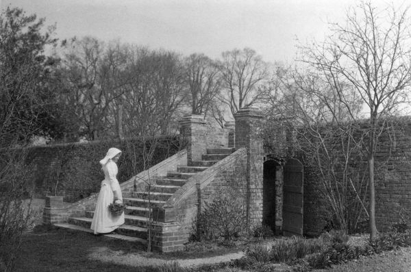 UFTON COURT, Ufton Nervet, Berkshire. A woman stands at the base of the garden steps. Photographed by Maxwell-Lyte, c.1901