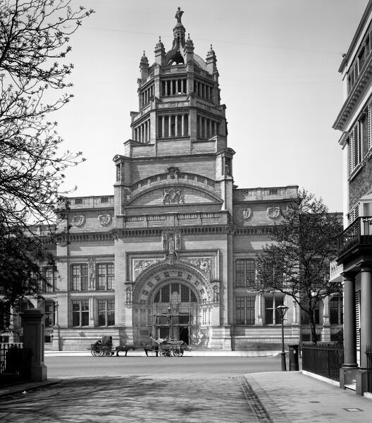 VICTORIA AND ALBERT MUSEUM, Cromwell Road, Kensington, London. The Victoria and Albert Museum with its high central tower was not officially opened to the public until 1909. Construction on the building itself had begun (on the designs of Aston Webb) in 1899
