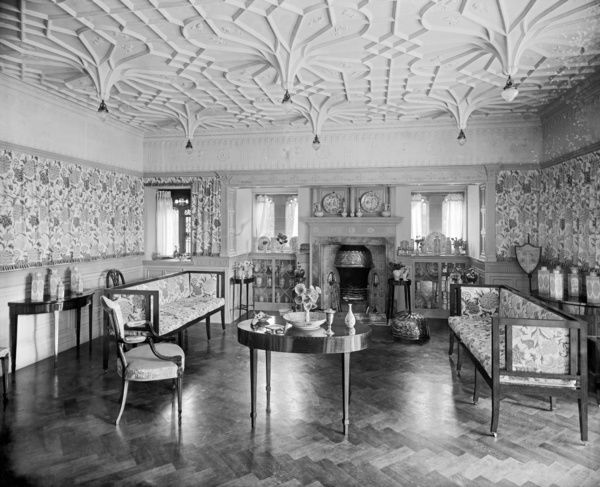 Bidston Court, Birkenhead. Victorian interior of the drawing room looking towards the windows and fireplace. Bidston Court was built in 1891 by the Liverpool architects Grayson & Ould. The drawing room is formally decorated, with Gothic windows