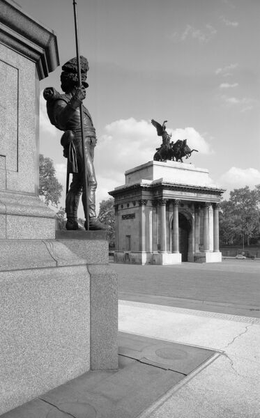 WELLINGTON ARCH, Westminster, London. General view of Wellington Arch (also known as Constitution Arch or the Green Park Arch) from the Wellington Statue. The arch has been in its present position since 1883, when it was removed from the old site
