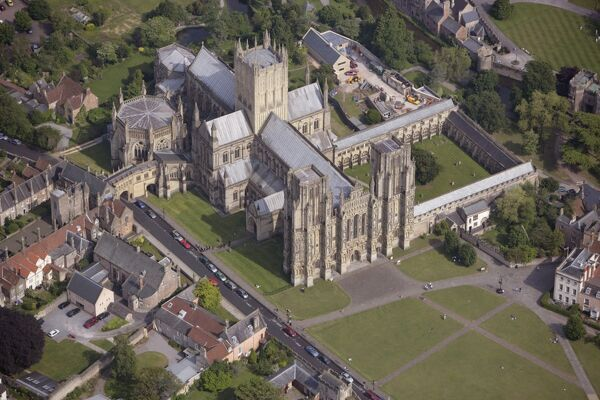 WELLS CATHEDRAL, Somerset. Seat of the Bishop of Bath and Wells, the cathedral is substantially in the Early English style typical of the late 12th and early 13th centuries. This aerial view is from June 2006