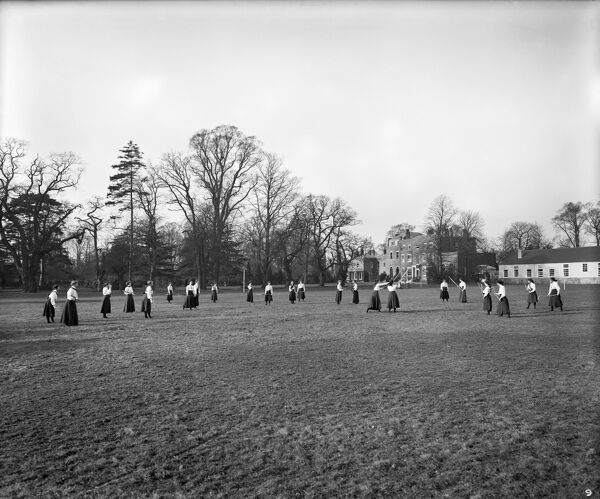 WEST HEATH SCHOOL FOR YOUNG LADIES, Ham Common, Richmond, London. Founded as a school in 1879, it was bought by two teachers in 1900, who commissioned this photograph as one of a series to promote the school. Lacrosse. Photographed in 1909 by Bedford Lemere