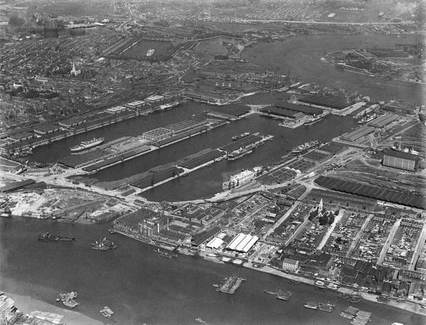 West India Docks, London. Showing stretches of the River Thames at either end of the docks. Aerial view by Aeropictorial. Aerofilms Collection. 1935