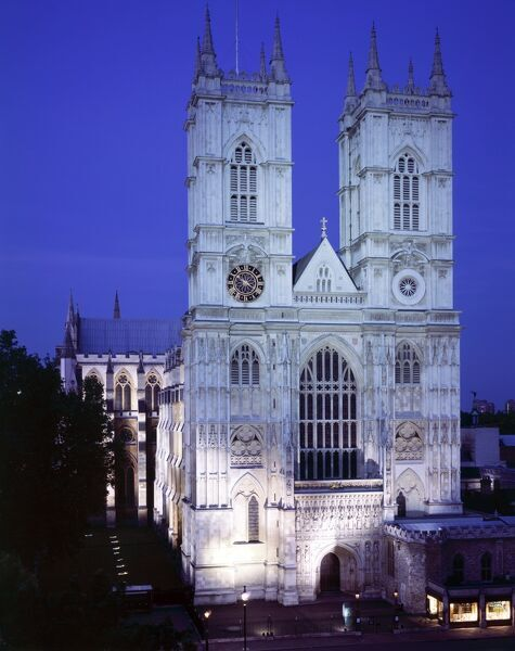 WESTMINSTER ABBEY, London. A front view of the west elevation at night