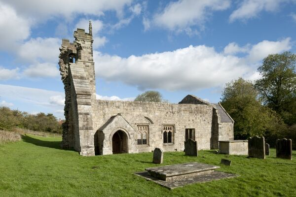 WHARRAM PERCY DESERTED MEDIEVAL VILLAGE, North Yorkshire. View of the Church of St Martin across the graveyard