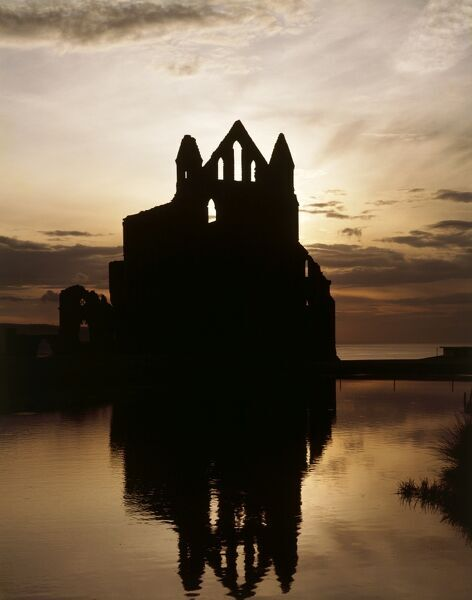 WHITBY ABBEY, North Yorkshire. Exterior view at sunset