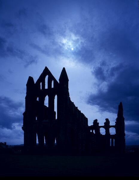 WHITBY ABBEY, North Yorkshire. Atmospheric silhouette of the ruins on a full moonlit night