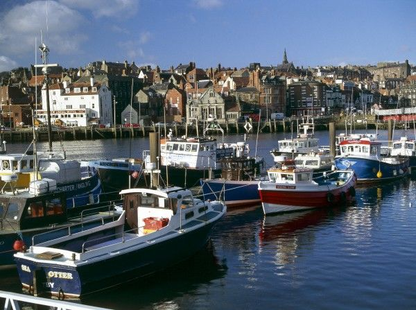 WHITBY, North Yorkshire. Inner harbour and boats from east side looking towards the town centre