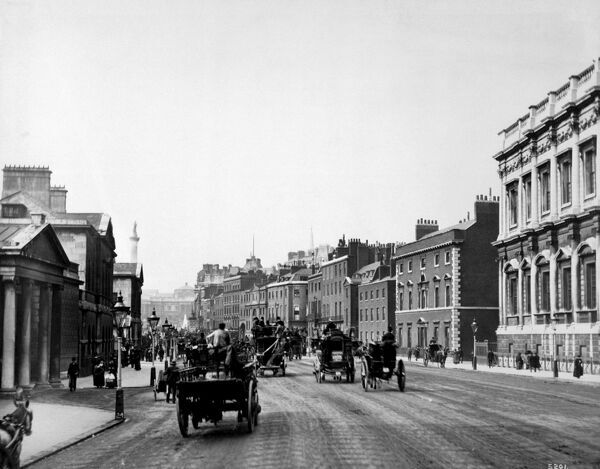 WHITEHALL, Westminster, London. Whitehall, looking north-east from Horse Guards, with the Banqueting House by Inigo Jones to the right and horse-drawn vehicles on the road